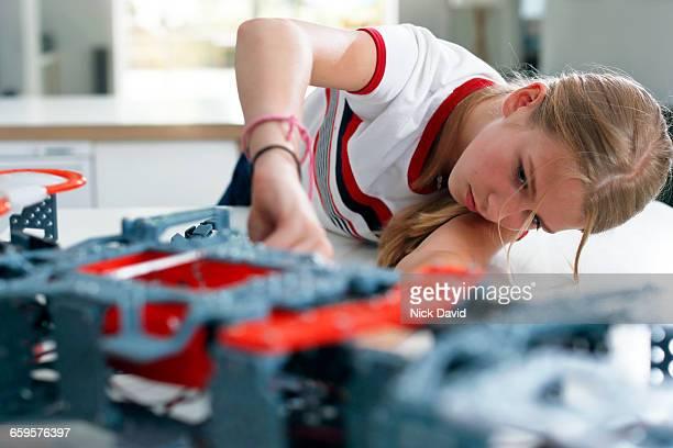 Girls building a robot