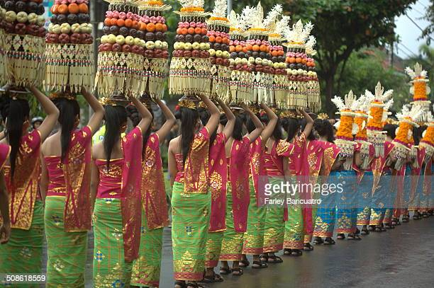 Girls carry 4foot offerings of fruits and flowers on their head in the 2013 Bali Arts Festival parade
