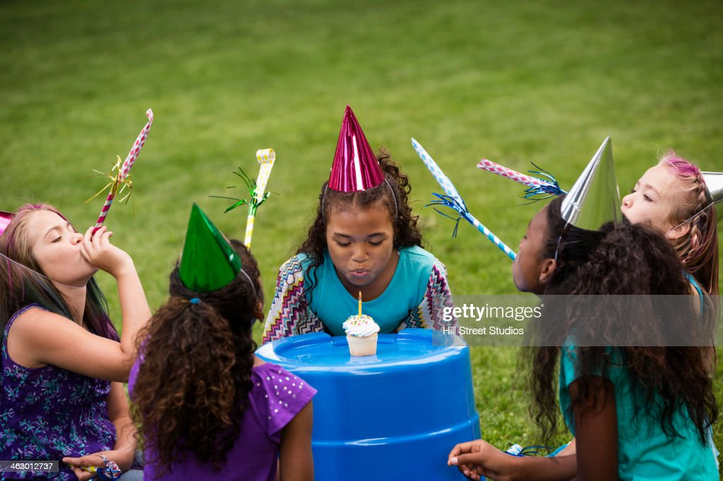 Girls celebrating birthday in backyard : Stock Photo