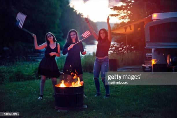 Girls celebrating Independence day in camping.