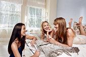 Girls chatting in bedroom