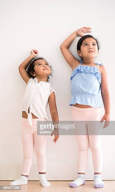 Girls checking how tall they've grown