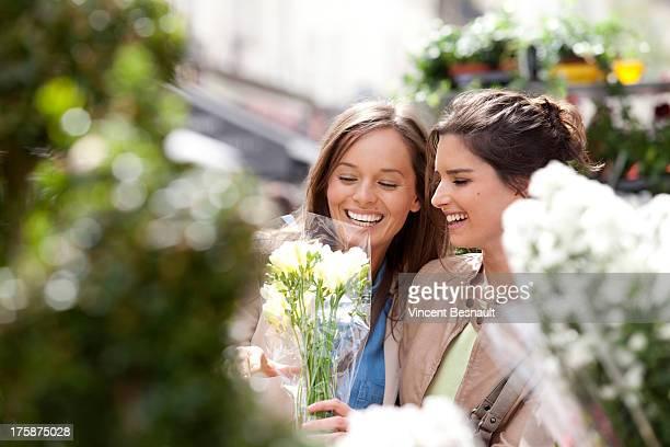 Girls choosing flowers