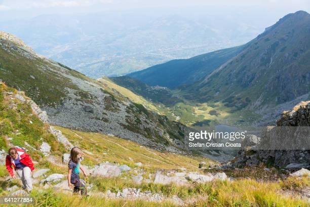 Girls climbing the mountain