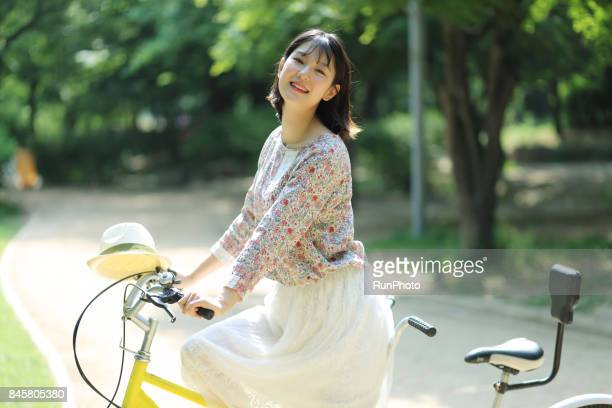 Girls college riding a bicycle