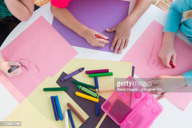 Girls coloring at desk