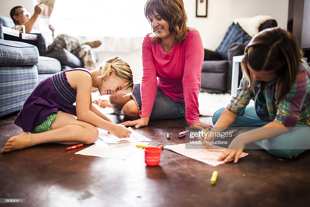 girls coloring with mother : Stock Photo