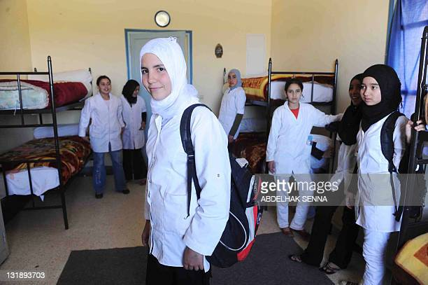 Girls come back from school to their hostel in the Ourika mountain region near Marrakech on April 14 2011 The hostel is one of 300 centers in Morocco...