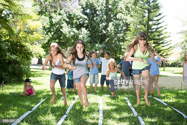 Girls competing in an egg-and-spoon race