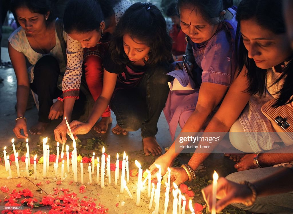 Girls condole by lighting candles for the death of Delhi rape case incident victim at Dadar on December 29, 2012 in Mumbai, India.The girl died of injuries in Singapore hospital after brutally gang raped in a moving bus on December 16, in Delhi.