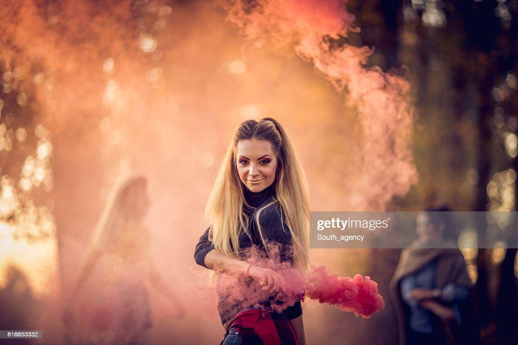 Girls covered in smoke : Stock Photo
