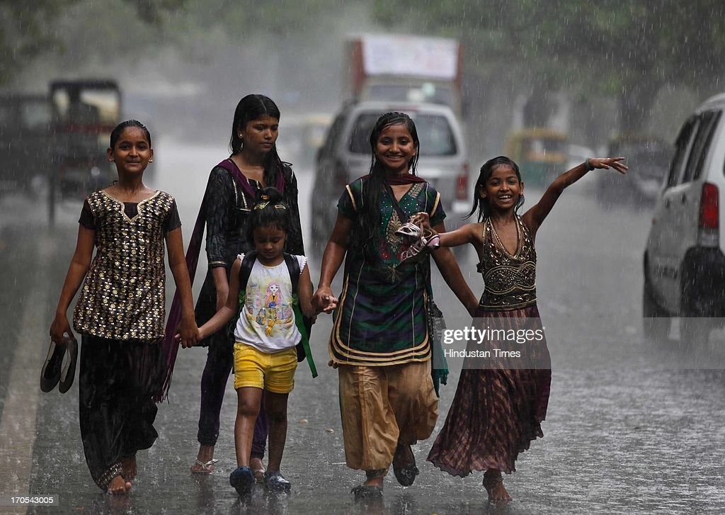 Girls dancing and enjoying the pre monsoon rain near Bal Bhawan on June 14, 2013 in New Delhi, India. The city received 11.6 mm rainfall and the humidity oscillated between 47 and 91 percent.
