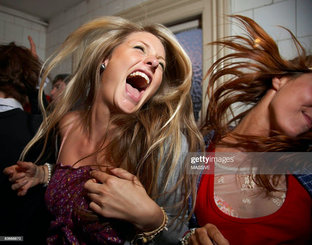 Girls dancing at a party : Stock Photo