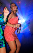 Girls dancing in disco light