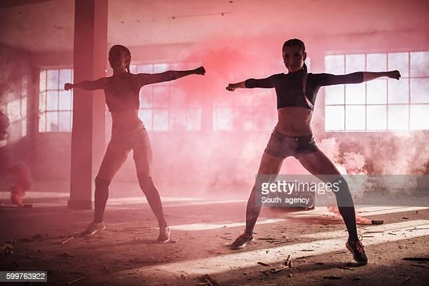 Girls dancing in pink smoke