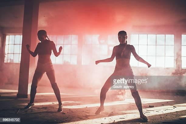 Girls dancing in red smoke