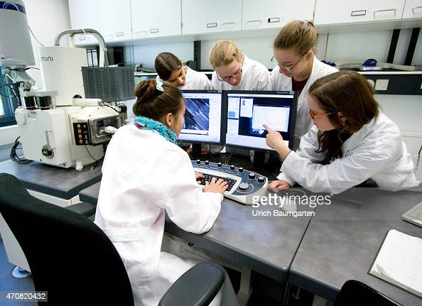 Girls day Caesar research center in Bonn Young school girls investigate under guidance insects and flowers on scanning electron microscope