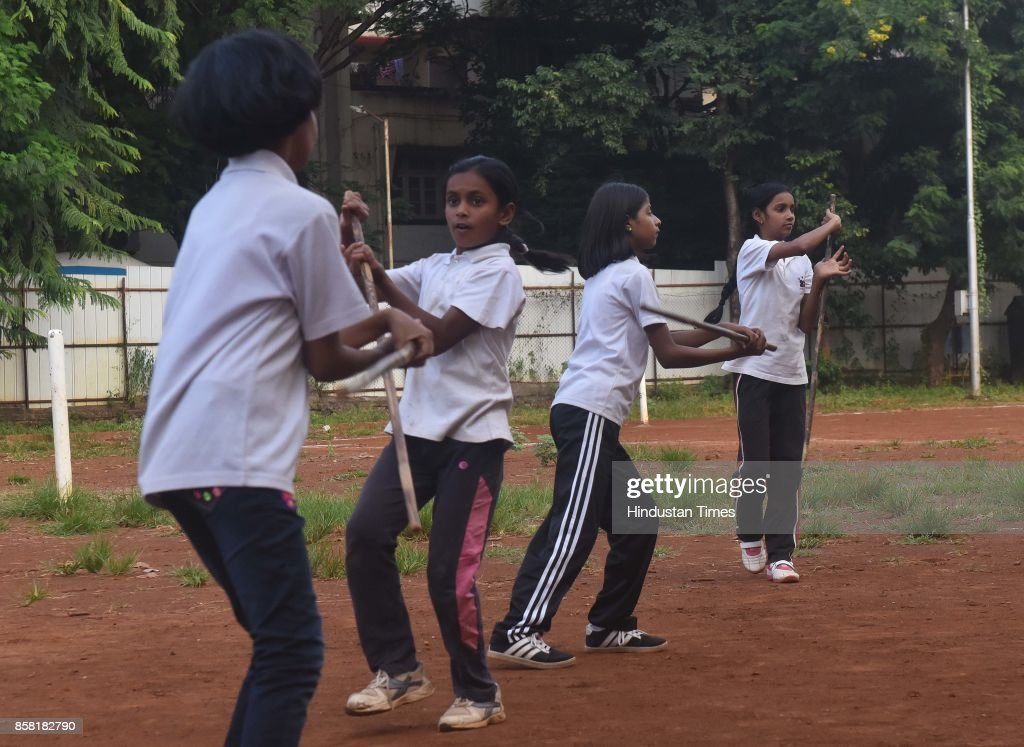 Girls display Single Stick, a type of Silambam, a weapon based Indian Martial arts, on October 4, 2017 in Pune, India. The word Silambam means either a mountain or merely to sound (as verb). While the Silambam fencers are fighting, the weapon makes sound. This might have been the cause for its being named as Silambam.