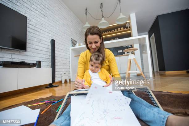 Girls drawing at home