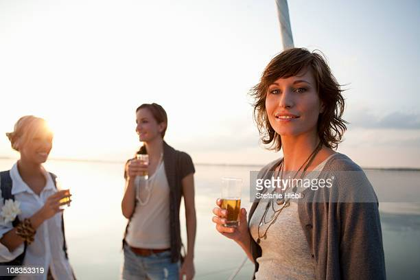 Girls drinking beer on boat
