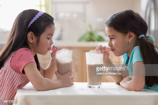 Girls drinking chocolate milk together