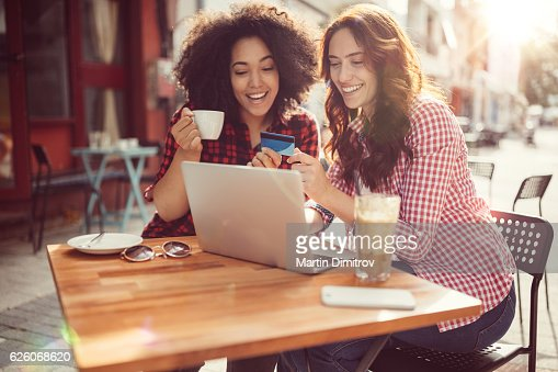 Girls drinking coffee and shopping online