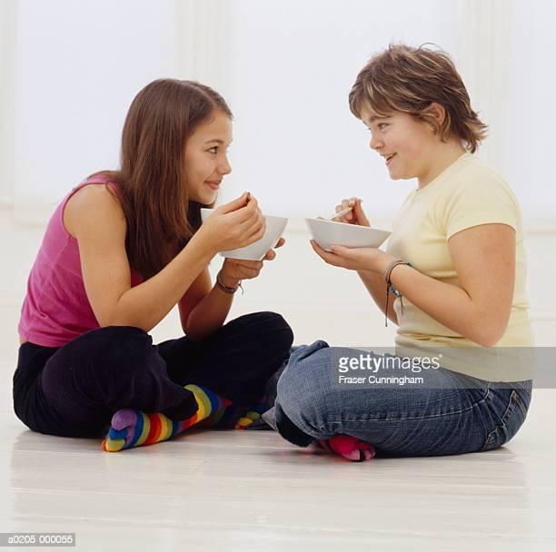 Girls Eating Cereal