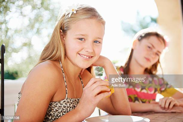 Girls eating fresh fruit