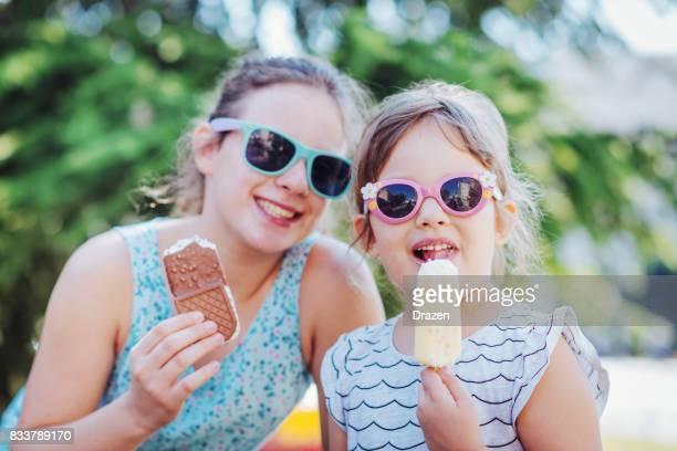 Girls eating ice-cream in summer
