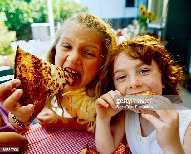 Girls eating pizza