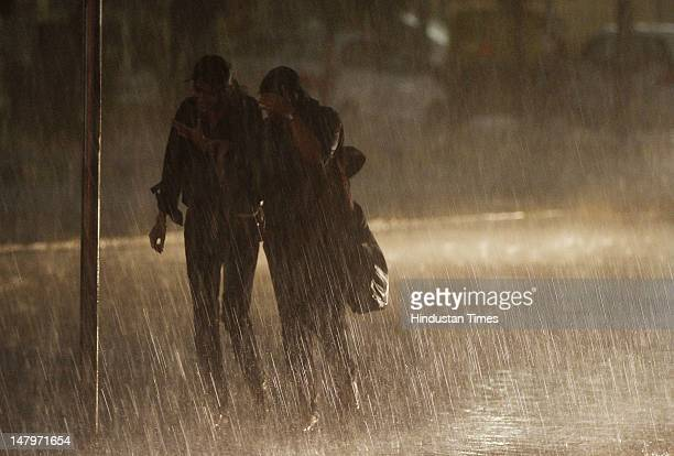 Girls enjoy the first rain of the season on July 6 2012 in New Delhi India After an elongated hot summer premonsoon rain brings a welcome respite for...