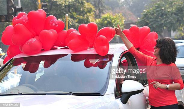 Girls enjoy with heart shape balloons as they celebrated Valentine's Day on February 14 2015 in Chandigarh India Valentine's Day also known as Saint...