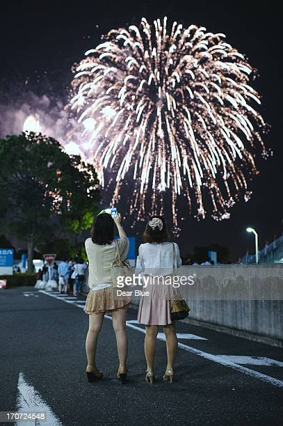 Girls enjoying evening fireworks in Yokohama
