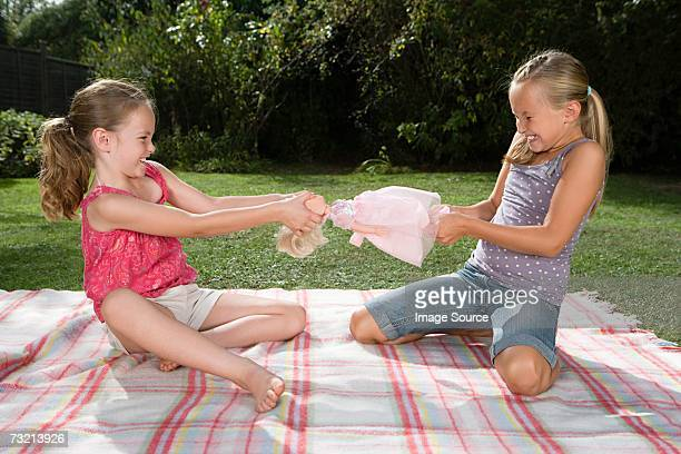 Girls fighting over doll