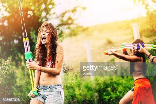 Girls fighting with squirt guns : Stock Photo
