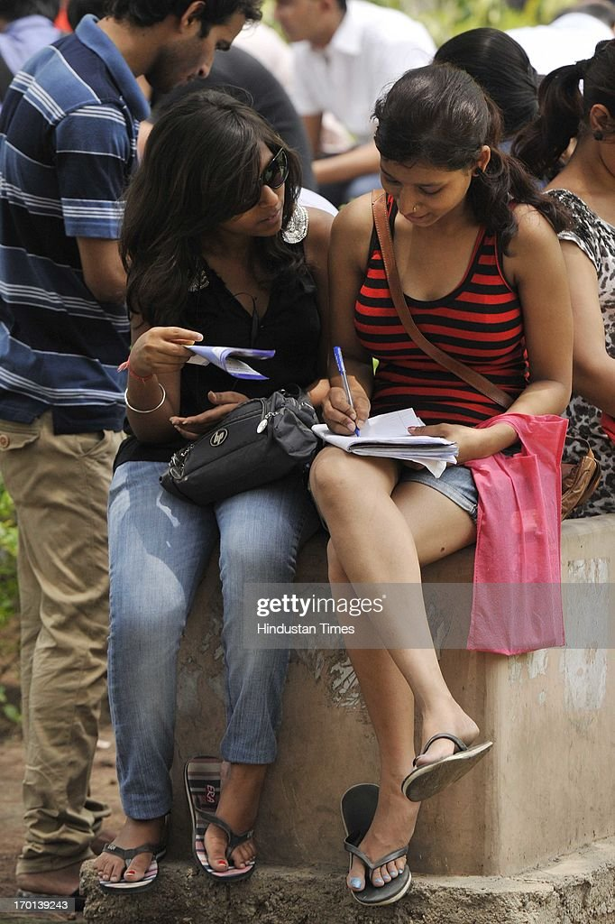 Girls filing their forms for admission in four-year undergraduate programme at North Campus of Delhi University on June 7, 2013 in New Delhi, India.