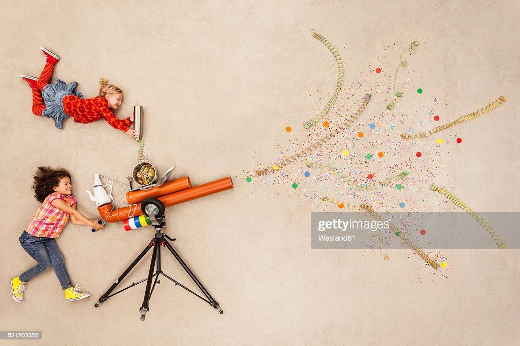 Girls firing confetti cannon
