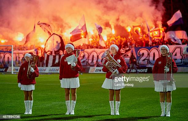 Girls from Aars Pigegarde entertains in front of fans with fireworks prior to the Danish Superliga match between Hobro IK and FC Copenhagen at DS...