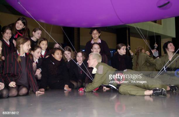Girls from Lady Margarets School in Fulham west London speak to Lindsey Butcher one of the Performance Artists who helped to create a gigantic flying...