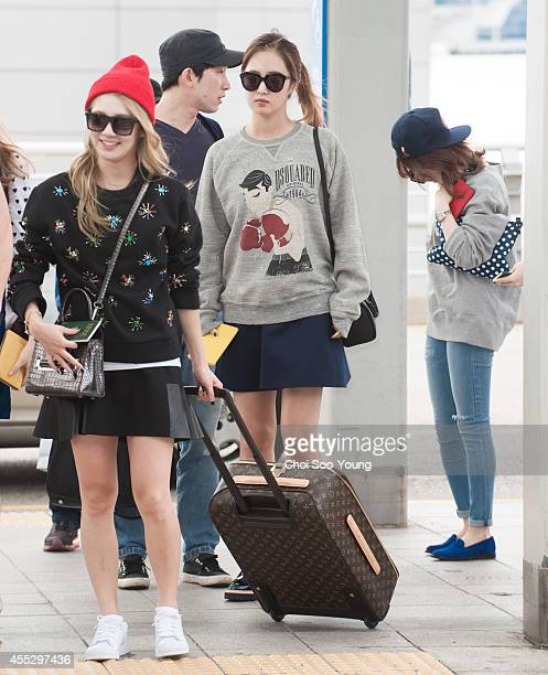 Girls' Generation are seen at Incheon International Airport on September 2 2014 in Incheon South Korea