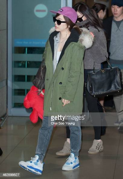 Girls' Generation are seen at Incheon International Airport on January 12 2014 in Incheon South Korea