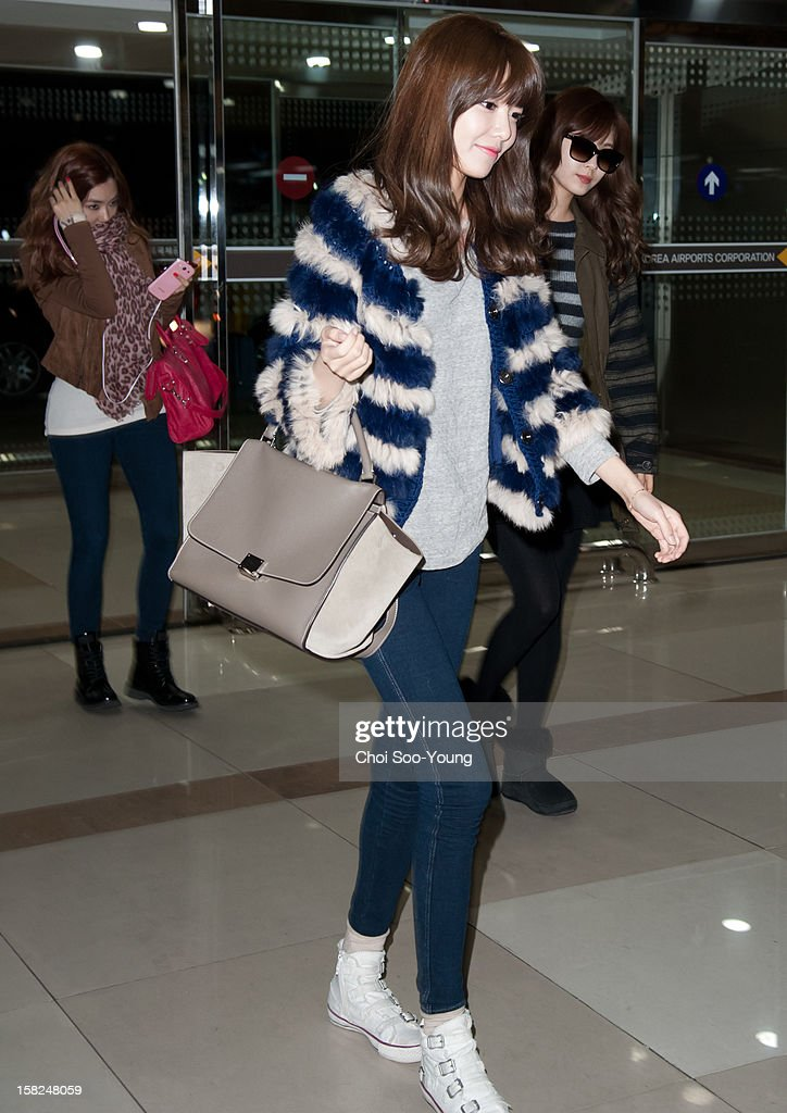 Girls' Generation is seen at Gimpo International Airport on December 4, 2012 in Seoul, South Korea.