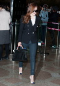Girls' Generation is seen at Gimpo International Airport on March 1 2014 in Gimpo South Korea