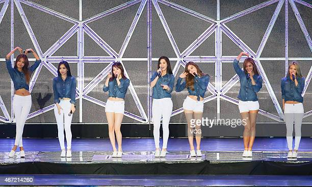 Girls' Generation pefrom on the stage during SM Town live concert on March 21 2015 in Taipei Taiwan of China