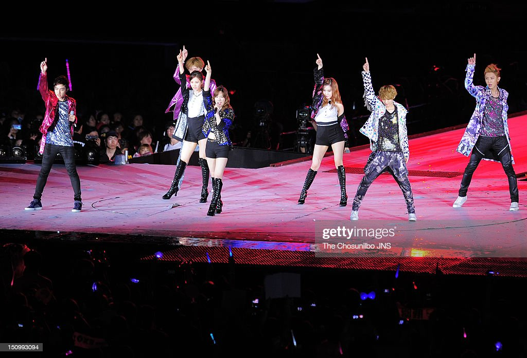 Girls' Generation-TTS and EXO perform during 'SM Town Live World Tour 3 In Seoul' at Jamsil Sports Complex on August 18, 2012 in Seoul, South Korea.
