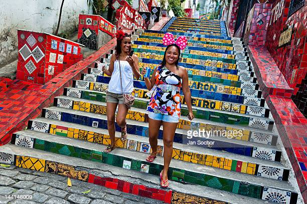 Girls go down the Selaron's Stairs a mosaic staircase made of colorful tiles on February 12 2012 in Rio de Janeiro Brazil World famous staircase...