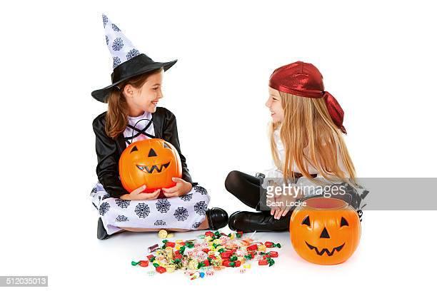 Girls going through Halloween candy