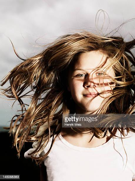 Girls hair blowing in wind outdoors