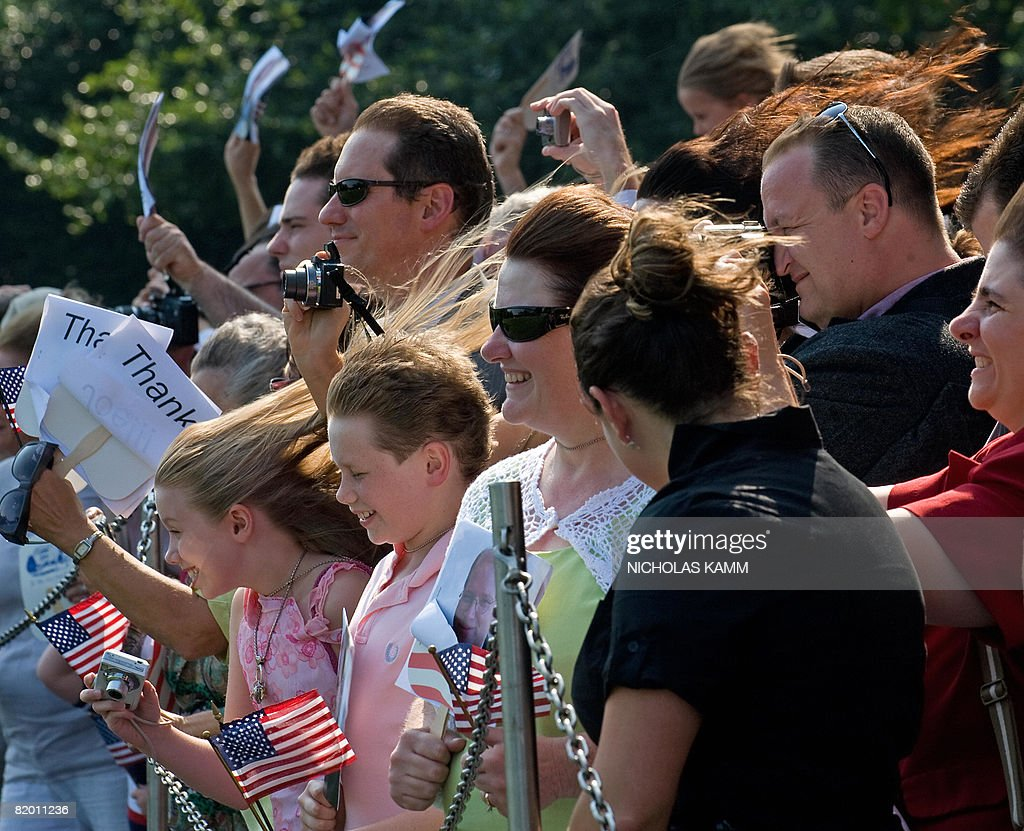 A girl's hair blows in the wind as presidential helicopter Marine One lands on the South Lawn as US President George W. Bush and First Lady Laura Bush arrive at the White House in Washington on July 20, 2008. Bush spent the weekend at his ranch in Crawford, Texas. AFP PHOTO/Nicholas KAMM