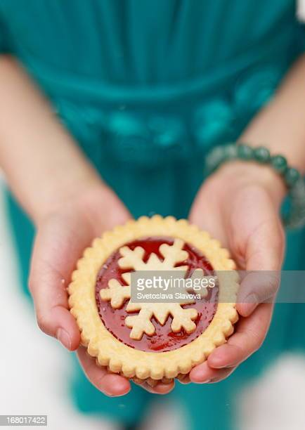 Girl's hands holding Christmas cookie